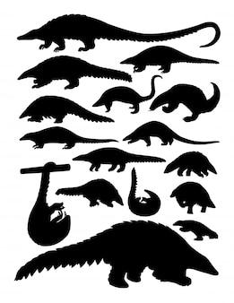 Silhuetas de animais pangolins.
