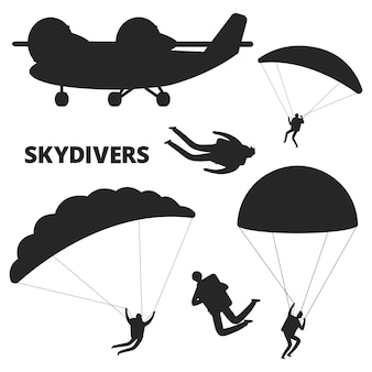 Silhuetas de avião e pára-quedistas em fundo branco