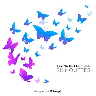 Silhuetas de borboleta enxame de fundo
