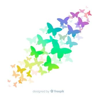 Silhuetas de borboleta gradiente voando