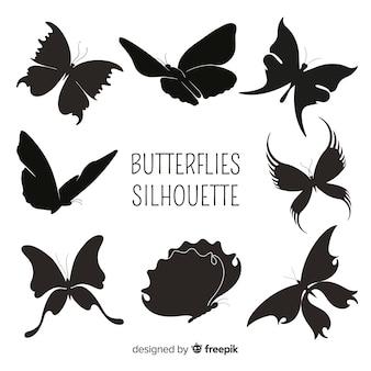Silhuetas de borboleta voando