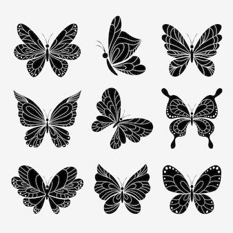 Silhuetas de borboletas em branco