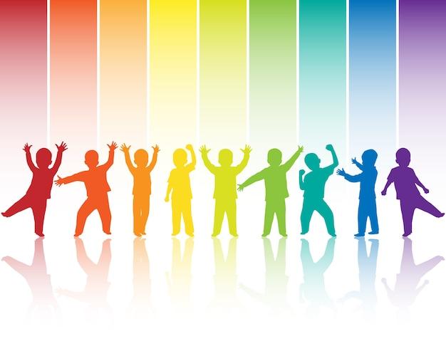 Silhuetas de crianças no fundo do arco-íris