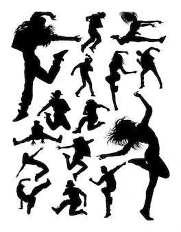 Silhuetas de dançarina moderna atraente.
