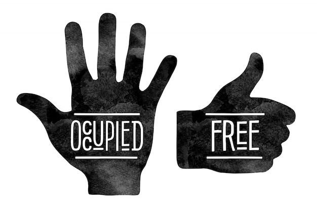 Silhuetas de mão negra com as palavras ocupado e livre
