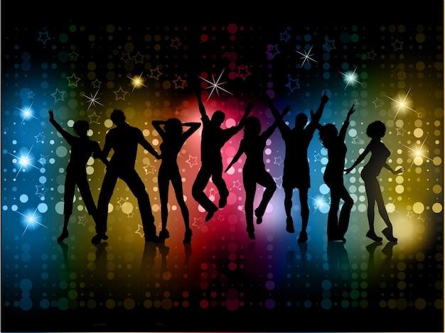 Silhuetas de pessoas dançando em um fundo abstrato com luzes brilhantes e estrelas