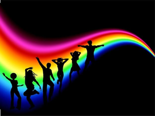 Silhuetas de pessoas descoladas dançando no arco-íris