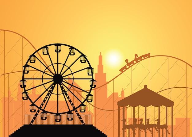 Silhuetas de uma cidade e parque de diversões