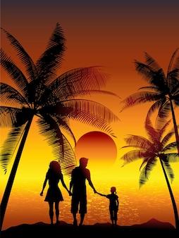 Silhuetas de uma família caminhando em uma praia tropical