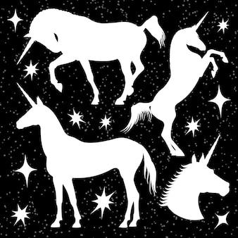 Silhuetas de unicórnio branco cravejado de estrelas no preto