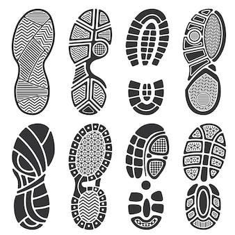 Silhuetas de vetor pegada isolado. sapatos sujos e pegadas de tênis