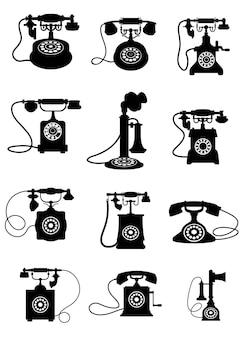 Silhuetas em preto e branco de telefones antigos isolados no fundo branco