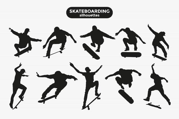 Silhuetas negras de skatistas em um cinza