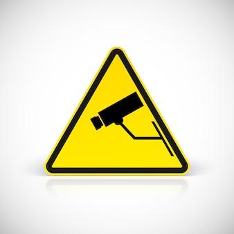 Símbolo de vigilância por vídeo. símbolo em sinal triangular