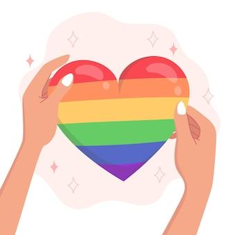 Símbolo em forma de coração do orgulho lgbtqi nas mãos