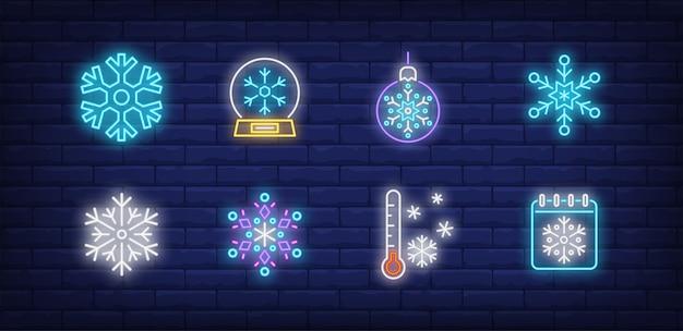 Símbolos de inverno definidos em estilo neon com flocos de neve