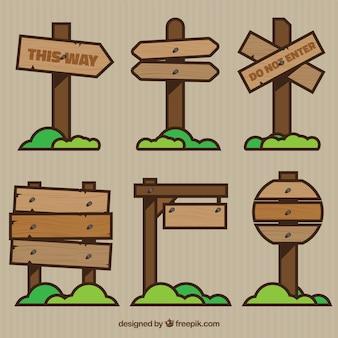 Sinais de madeira com estilo dos desenhos animados