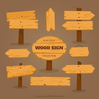 Sinais de madeira com sombras