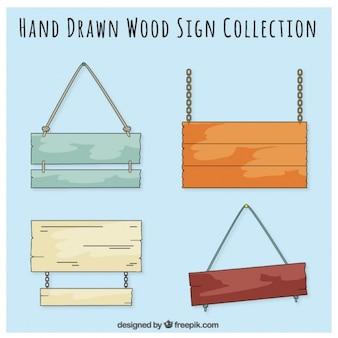 Sinais de madeira desenhado mão