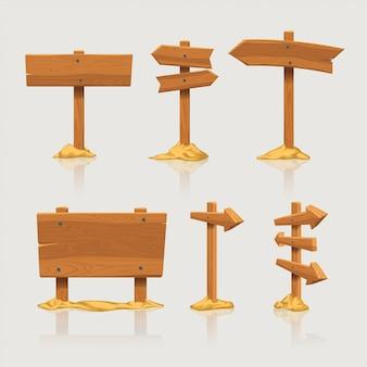 Sinais direcionais de madeira com areia