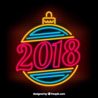 Sinal brilhante de neon do ano novo com bola de natal
