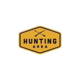 Sinal de área de caça amarelo com arma cruzada e seta