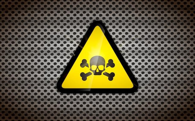 Sinal de aviso amarelo com caveira preta na grade metálica, fundo industrial