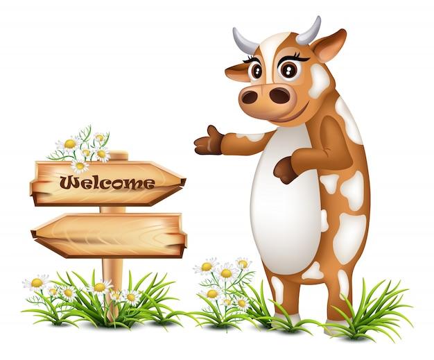 Sinal de madeira de boas vindas com uma ilustração de vaca feliz