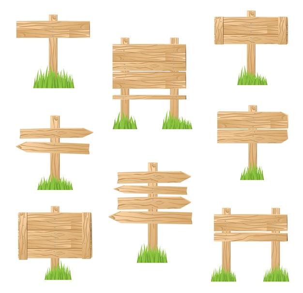 Sinal de madeira em pé na grama verde.