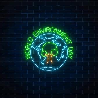 Sinal de néon brilhante do dia mundial do ambiente com o símbolo da árvore na globo