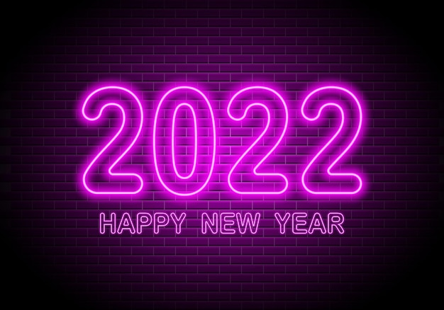 Sinal de néon de 2022 números texto brilhante de feliz ano novo no fundo da parede de tijolos