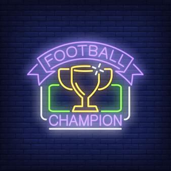 Sinal de néon de campeão de futebol. Copa na moldura retangular e fita no fundo da parede de tijolo
