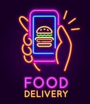 Sinal de néon de entrega de comida. banner brilhante com a mão segurando o smartphone com hambúrguer. aplicativo móvel para conceito de vetor de ordem de café de fast food online. dedo tocando a tela para comprar refeição no aplicativo