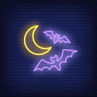 Sinal de néon de morcegos voando