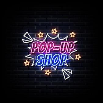 Sinal de néon na porta da loja pop-up na parede preta
