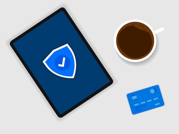 Sinal de proteção azul é mostrado no tablet. um café e um cartão bancário perto dele.