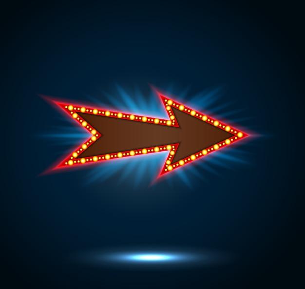 Sinal de seta com lâmpadas em fundo azul