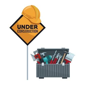 Sinal de trânsito no poste com capacete e caixa de ferramentas