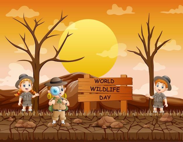 Sinal do dia mundial da vida selvagem com o menino e a menina exploradores