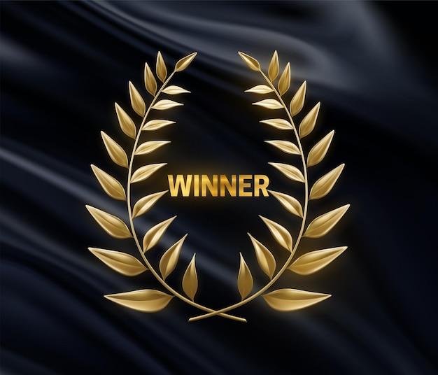 Sinal do vencedor dourado com coroa de louros dourada em tecido preto drapeado