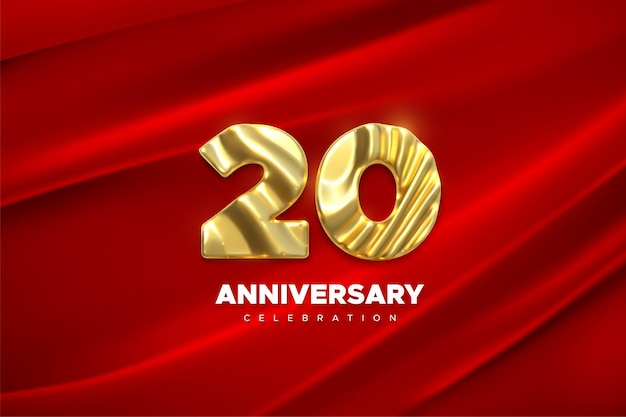Sinal dourado de celebração do 20º aniversário em tecido de seda drapeado vermelho
