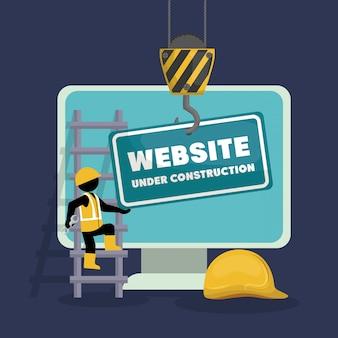 Site em construção com computador desktop