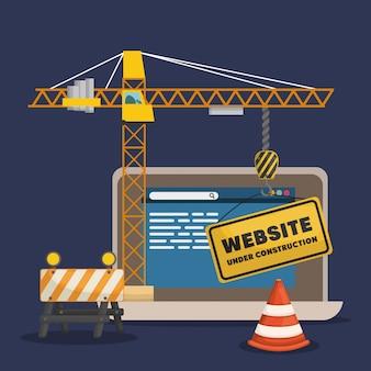 Site em construção com laptop