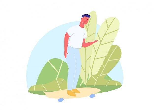 Skatista em t-shirt e calças stands perto de bush