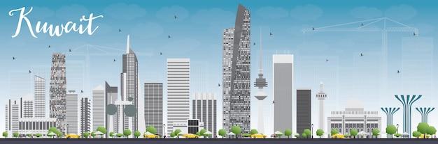 Skyline da cidade do kuwait com edifícios de cinza e céu azul.