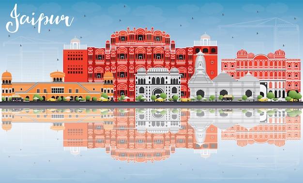 Skyline de jaipur com marcos de cor, céu azul e reflexões.
