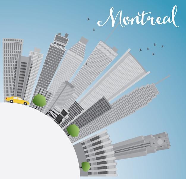 Skyline de montreal com edifícios cinza, céu azul e espaço de cópia.