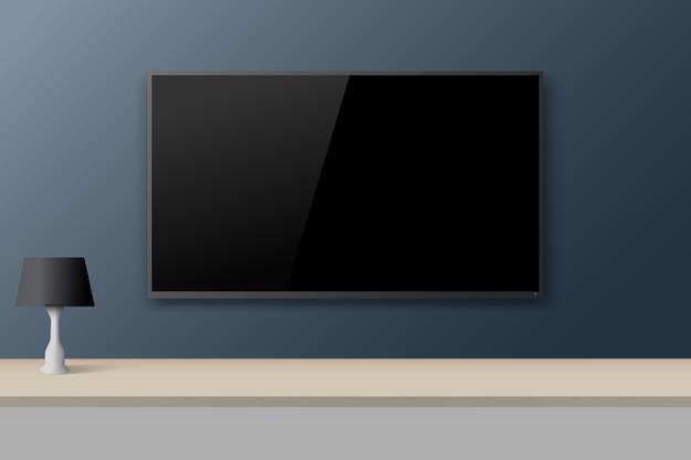 Smart tv na parede azul da sala.