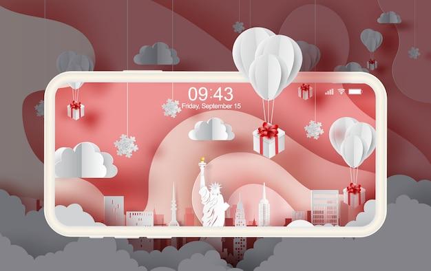 Smartphone do presente dos balões que flutua em new york city.