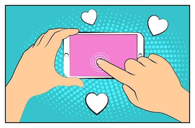 Smartphone em quadrinhos com sombras de meio-tom. mão segurando o smartphone. estilo retro da pop art.